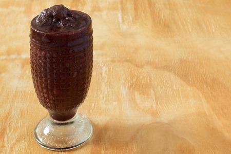 acai: Acai frozen pulp juice in glass. Selective focus. Copy space