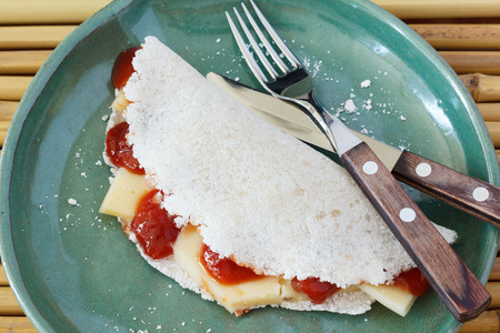 romeo and juliet: Casabe (bammy, beiju, bob, biju) - flatbread made from cassava (tapioca) with cheese and goiabada jam (Romeo and Juliet dessert). Selective focus