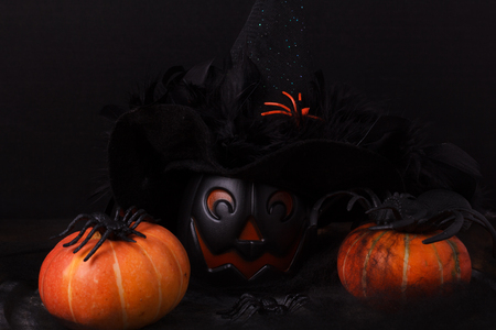 witch hat: Halloween pumpkins, spider, spider web, witch hat. Selective focus. Copy space. Stock Photo