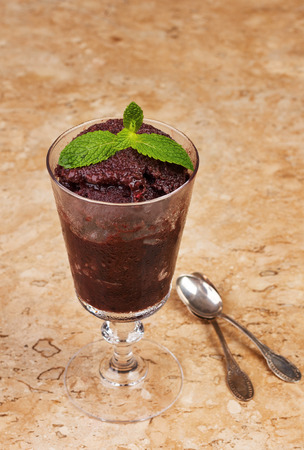 acai: Acai pulp in glass with fresh mint on marble table. Selective focus