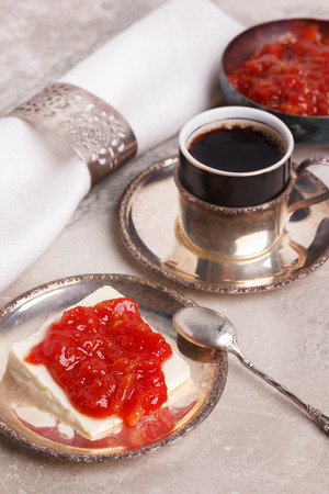 romeo and juliet: Brazilian dessert Romeo and Juliet, goiabada jam of guava and cheese Minas with vintage silver cup of coffee on marble table. Selective focus