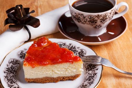 Cheesecake with goiabada jam, cup of coffee. Selective focus