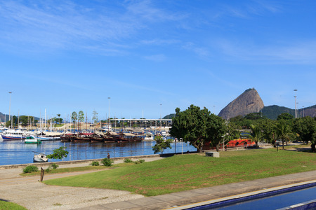 gloria: RIO DE JANEIRO - March 21: Ships and yachts in Marina da Gloria witn mountain Sugarloaf on background on March 21, 2016 in Rio de Janeiro. It is the base for the sailing competitions taking place in the waters of Guanabara Bay