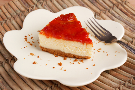 Cheesecake with brazilian goiabada jam of guava on plate on wooden table. Selective focus