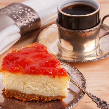 Cheesecake with brazilian goiabada jam of guava on silver vintage plate with coffee. Selective focus