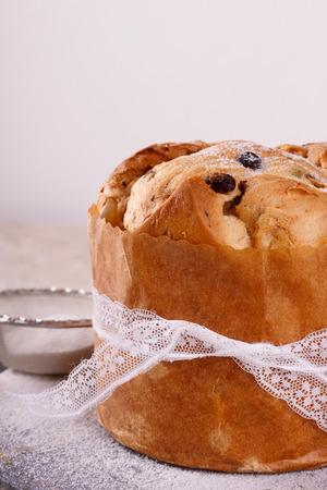 Panettone - sweet bread loaf traditional for Christmas and New Year. Selective focus. Copy space Stock Photo