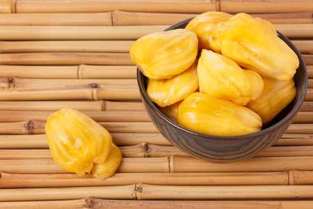 karnataka: Tropical fruit Jackfruit (jakfruit, jack, jak) in bowl on bamboo. Selective focus