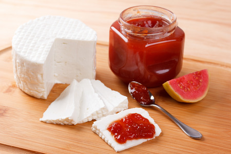 Brazilian dessert Romeo and Juliet, goiabada jam of guava and cheese Minas on wooden board. Selective focus Stock Photo