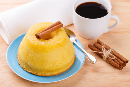 Sweet dessert Orange cake with cinnamon and cup of coffee. Selective focus