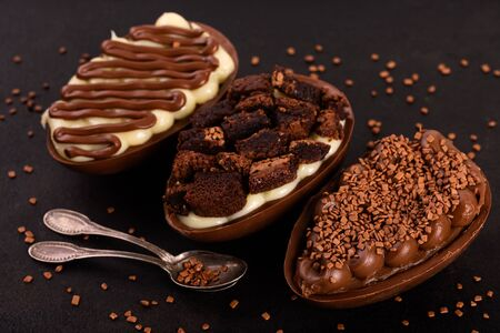 Chocolate egg with filling of brigadeiro cake for Easter on black