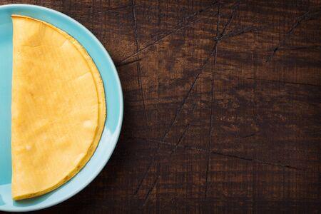 Cooking crepioca - pancake of cassava (tapioca) gluten-free on wooden background. Selective focus. Copy space 免版税图像 - 145602245