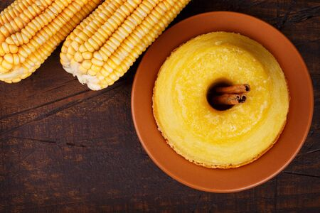 Brazilian sweet dessert corn cake with cinnamon. Selective focus. Copy space