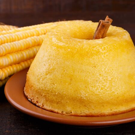 Brazilian sweet dessert corn cake with cinnamon. Selective focus 免版税图像
