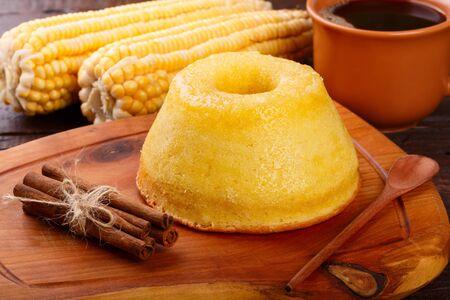 Brazilian sweet dessert corn cake with cinnamon and cup of coffee. Selective focus 免版税图像 - 145164423