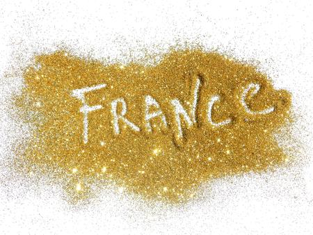 glister: Blurry inscription France on golden glitter sparkles on white background