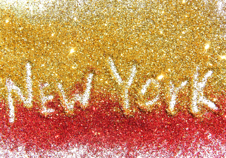 Inscription New York on golden and red glitter sparkle on white background