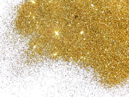 Golden glitter on white background