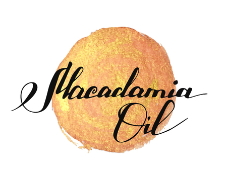 Hand written words Macadamia Oil on golden paint splash on white background