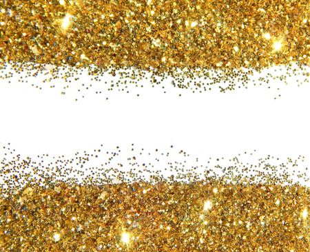 Golden glitter sparkles on white background. Can be used as place for text, for greeting or invitation cards, fashion magazines, web sites etc.
