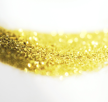 Beautiful blurry background with golden glitter in vintage colors Stock Photo