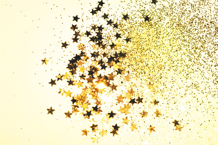 Golden glitter and glittering stars in vintage colors 免版税图像