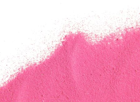 Textured background with pink sand on white
