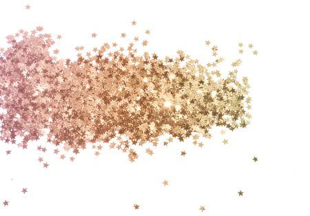 Glittering golden stars on white background in vintage colors
