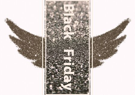 Black Friday - text on rectangular background with abstract wings of black glitter