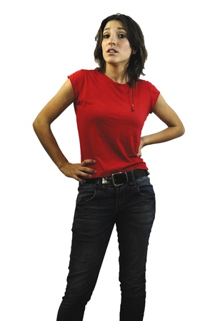 Portrait of a young happy woman with red shirt, jeans and white background