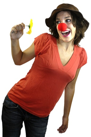 Young girl smiling clown on white background