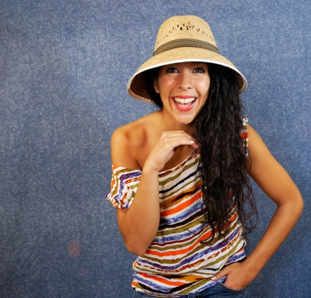 Beautiful latin young womanl with shirt colors and hat photo