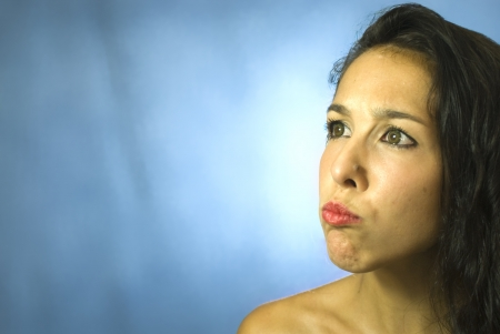 edelegance: Face of beautiful young woman on blue background