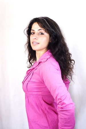 Portrait of a young woman with pink shirt and white background