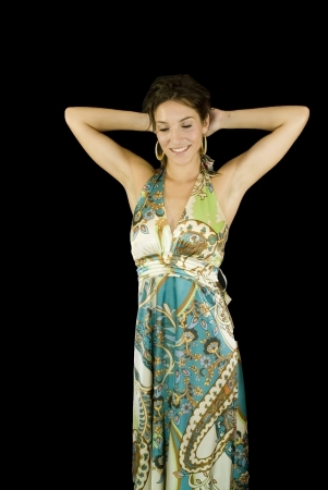 Beautiful woman with colorful dress on black background