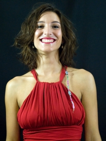 Beautiful woman with red dress on black background Stock Photo