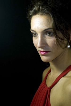 edelegance: Portrait of beautiful young woman on black background Stock Photo