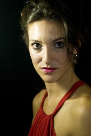Portrait of beautiful young woman on black background Banco de Imagens