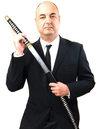 Senior business man with katana Stock Photo