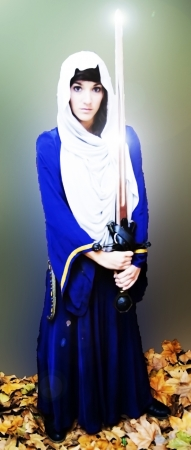 Portrait of a beautiful medieval woman with a shining sword Stock Photo - 17471818
