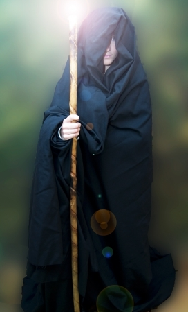 Portrait of a beautiful woman in medieval tunic and walking stick Stock Photo - 17471908