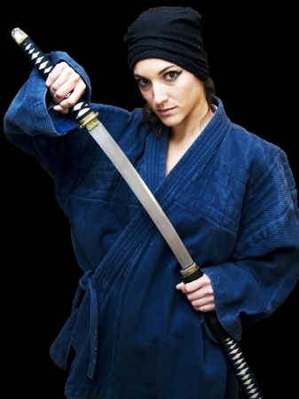 Portrait of a beautiful woman with japanese clothing wielding a katana Stock Photo - 17471801