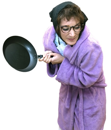 Old woman with frying pan Stock Photo - 17532814