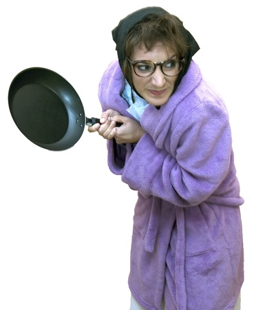 Old woman with frying pan Stock Photo - 17532803