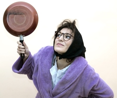 Old woman with frying pan photo