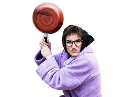 Old woman with frying pan Stock Photo - 17532835