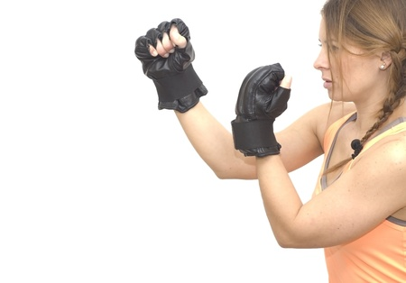 Beautiful woman with boxing gloves on white background photo