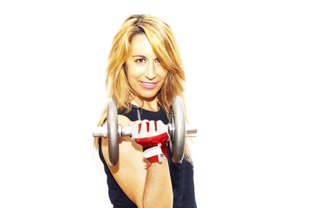 Beautiful woman lifting dumbbell on white background photo