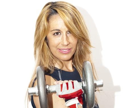 Beautiful woman lifting dumbbell on white background photo