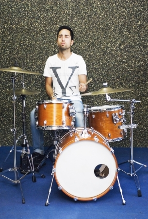 Young musician playing drums Stock Photo