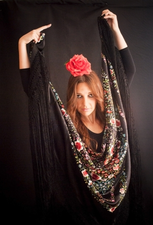 spanish style: Beautiful woman with typical dress of flamenco in Spain on black background